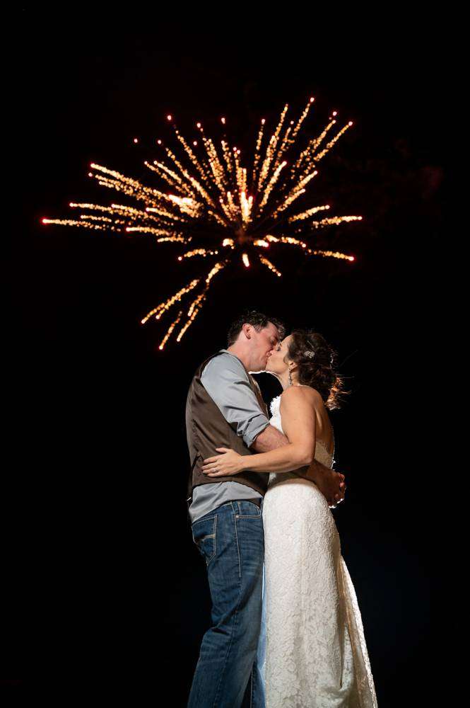 wedding couple with fireworks exploding in the sky