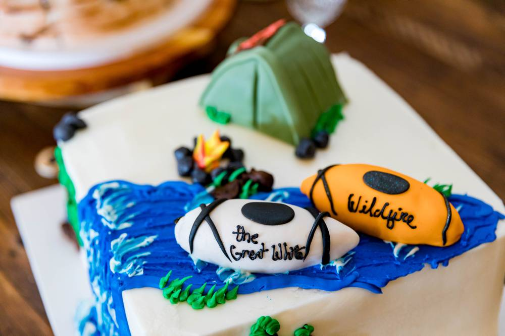groom cake with tent and canoes