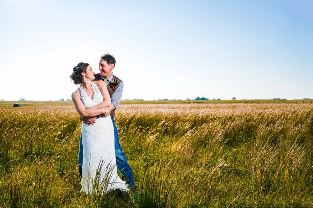 couple portraits in field at The Lodge at Rock Creek