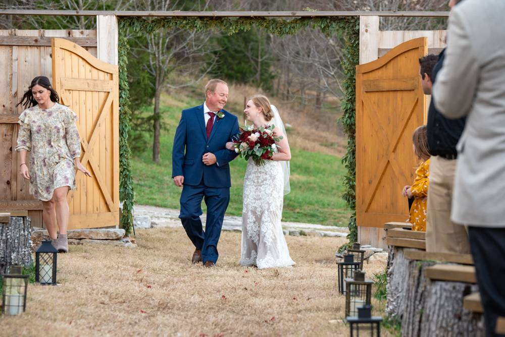 bride walking down the aisle at Under the Woods wedding venue
