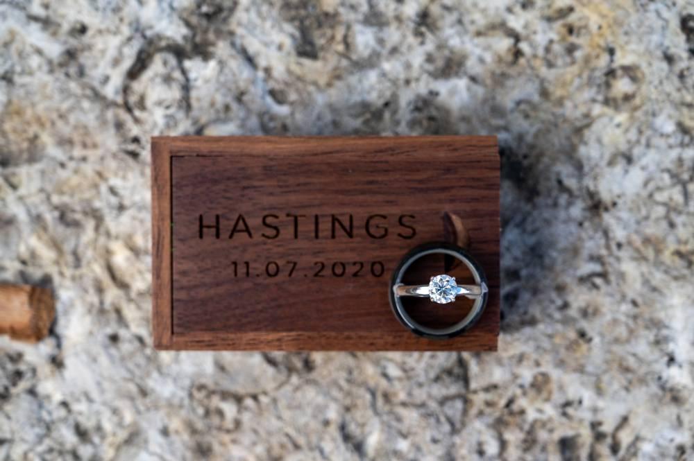 Wedding rings with custom wood box with wedding date
