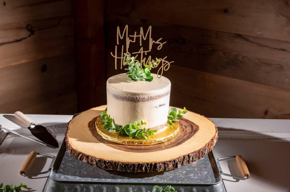 wedding cake on wood platter