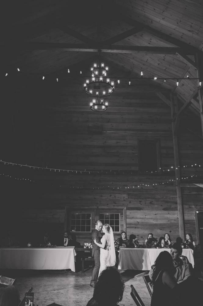 black and white photo of first dance at Under the Woods