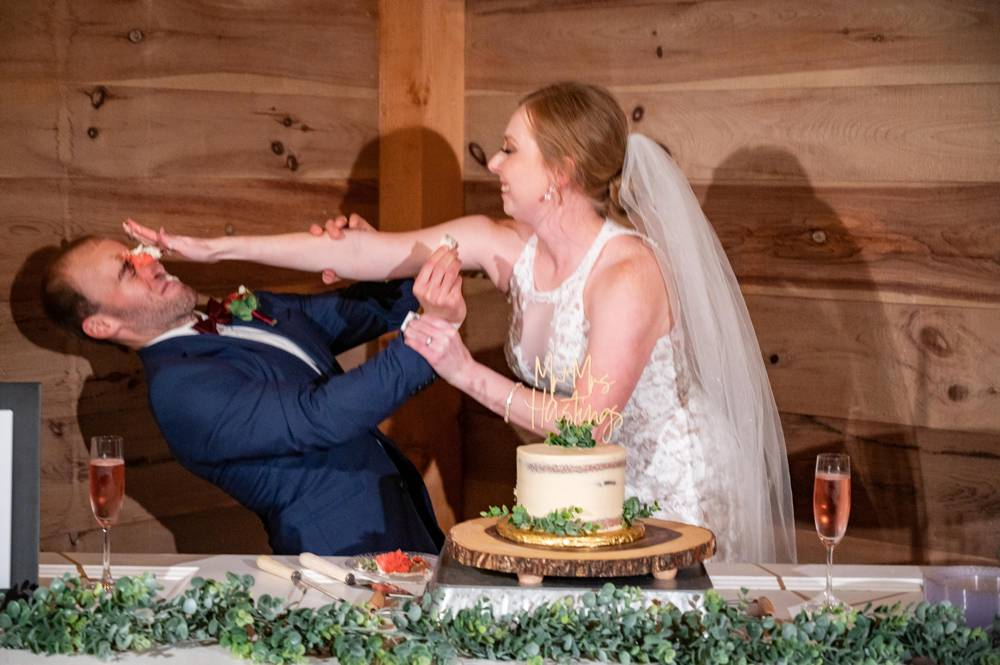 bride smashing cake into groom's face