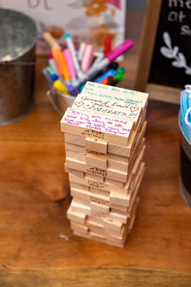 Jenga blocks at wedding for guests to sign