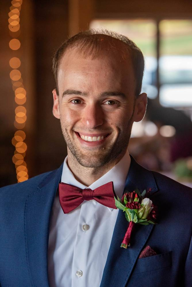portrait of groom with red bowtie