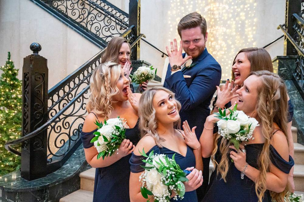 bridesmaids swooning over groom