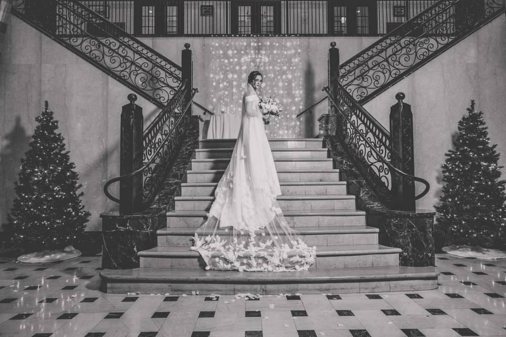 bride on staircase at Mayo Hotel in Tulsa black and white