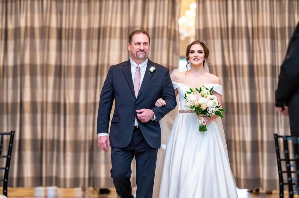 bride walking down the aisle at Mayo Hotel