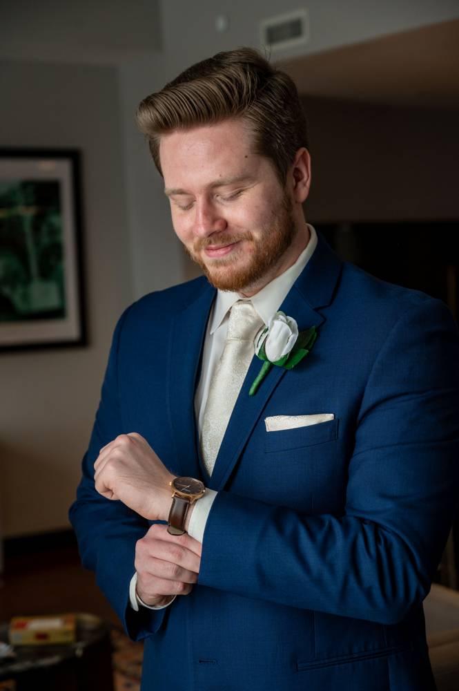 groom getting ready at Mayo Hotel in Tulsa