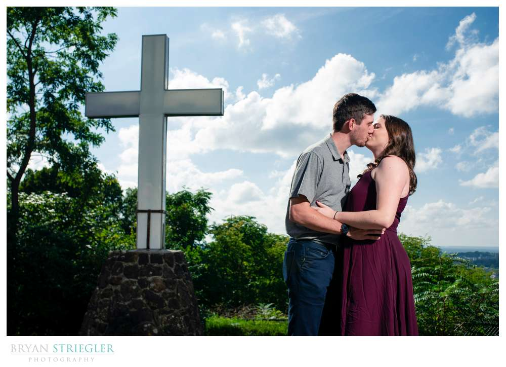 engagement photo in front of a cross