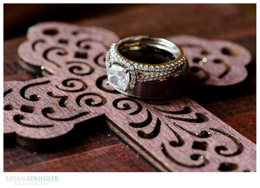 Wedding rings on custom ring box with cross