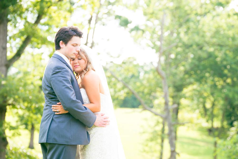 bride and groom outdoors hugging