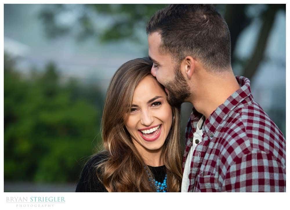 engagement photo kissing forehead