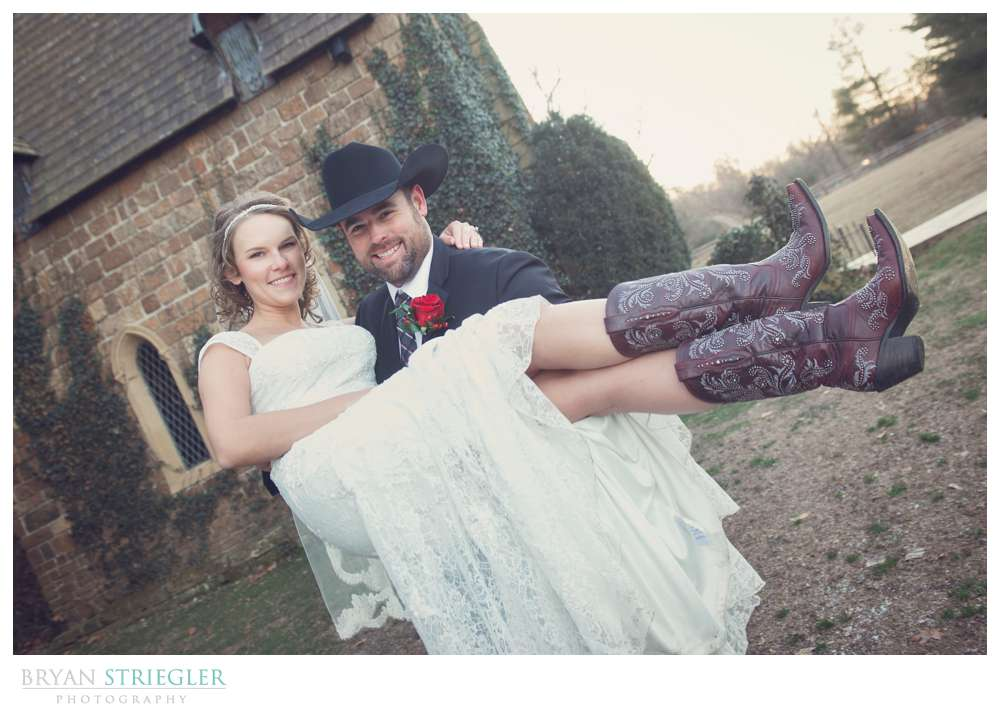 Fayetteville Wedding Photographer carrying bride cowboy boots