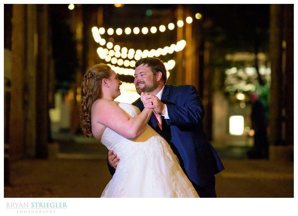wedding couple portrait with Christmas lights