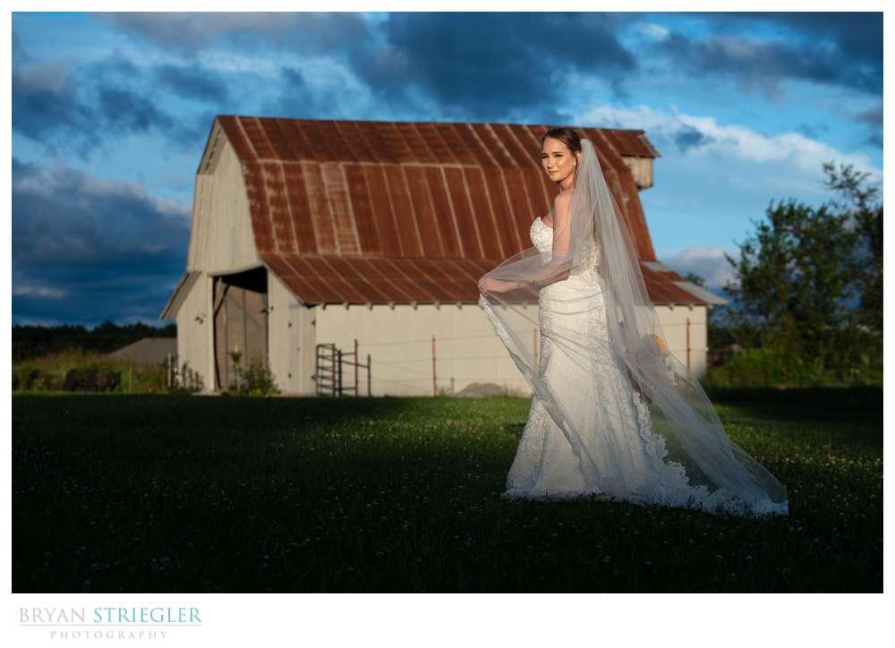 bride with barn