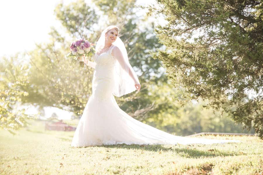 bridal portrait in field at Sassafras Springs Vineyard