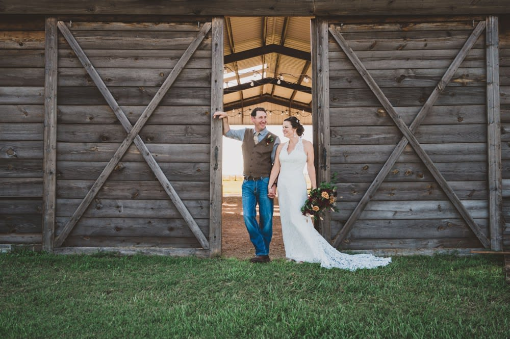wedding couple in front of barn doors
