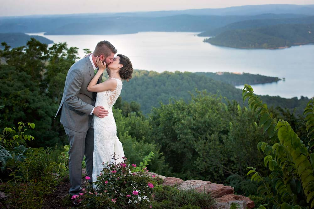 bride and groom looking over Beaver Lake at Whitney Mountain Lodge