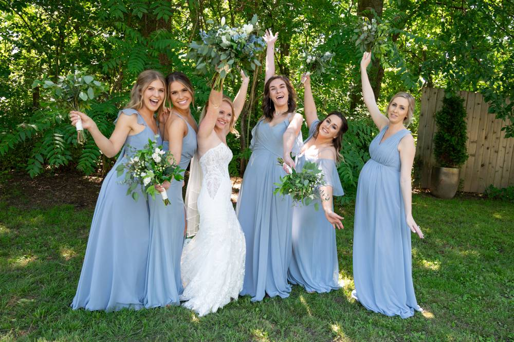 bridesmaids celebrating with bride at Matt Lane Farm