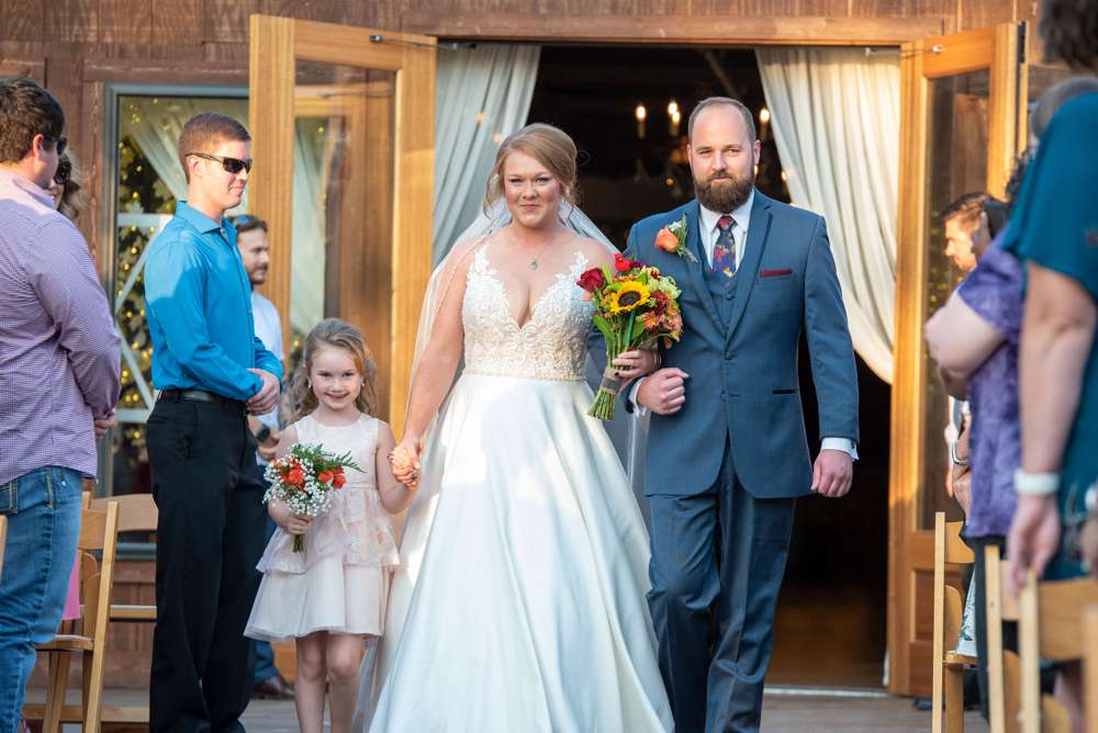 brother walking bride down the aisle