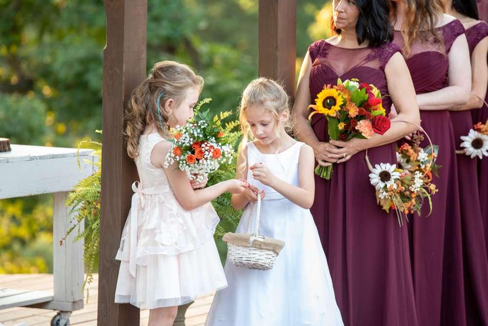 two flower girls talking