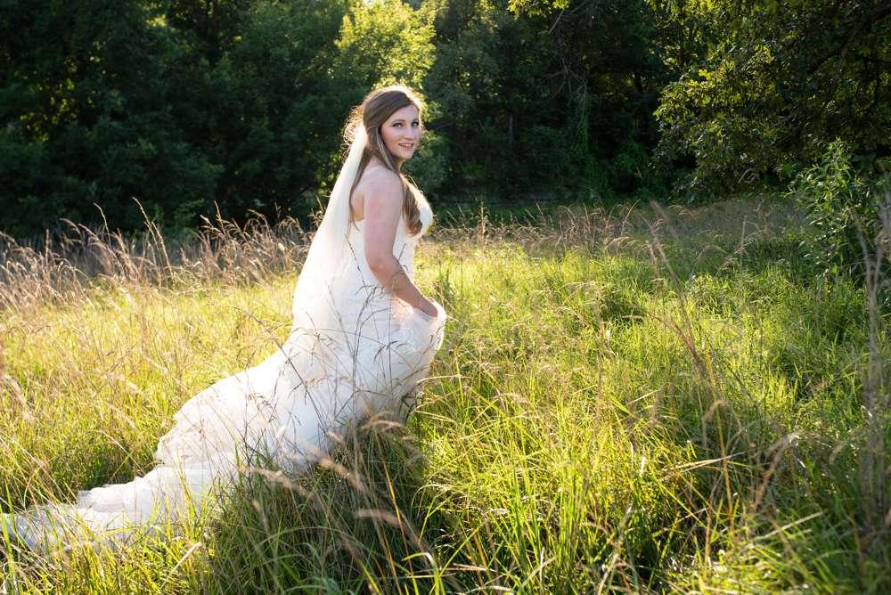 bride walking in high grass