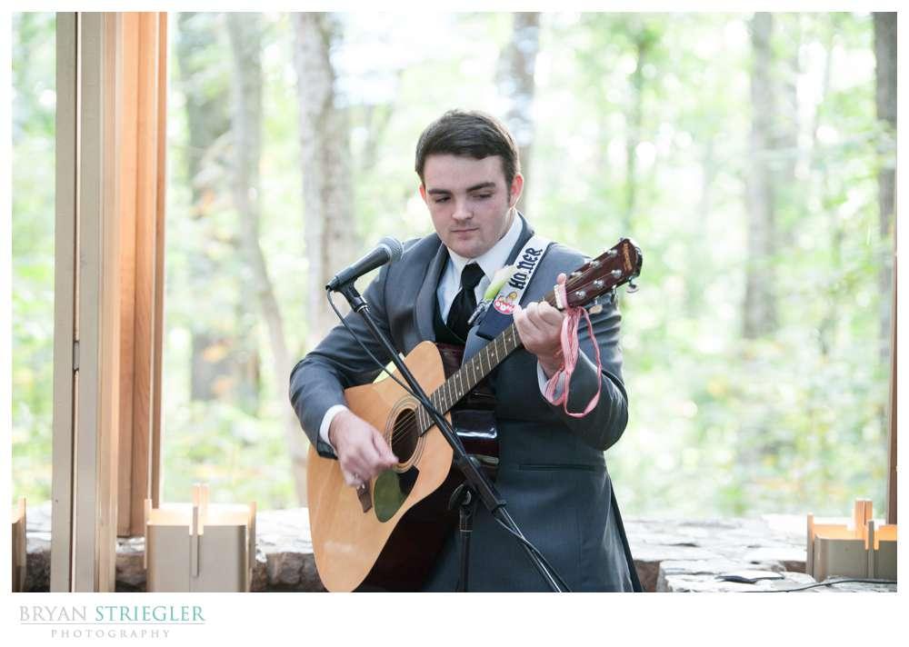 Creative wedding son playing guitar