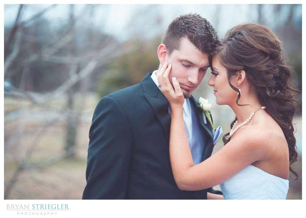 Fayetteville wedding photographer portrait holding his head