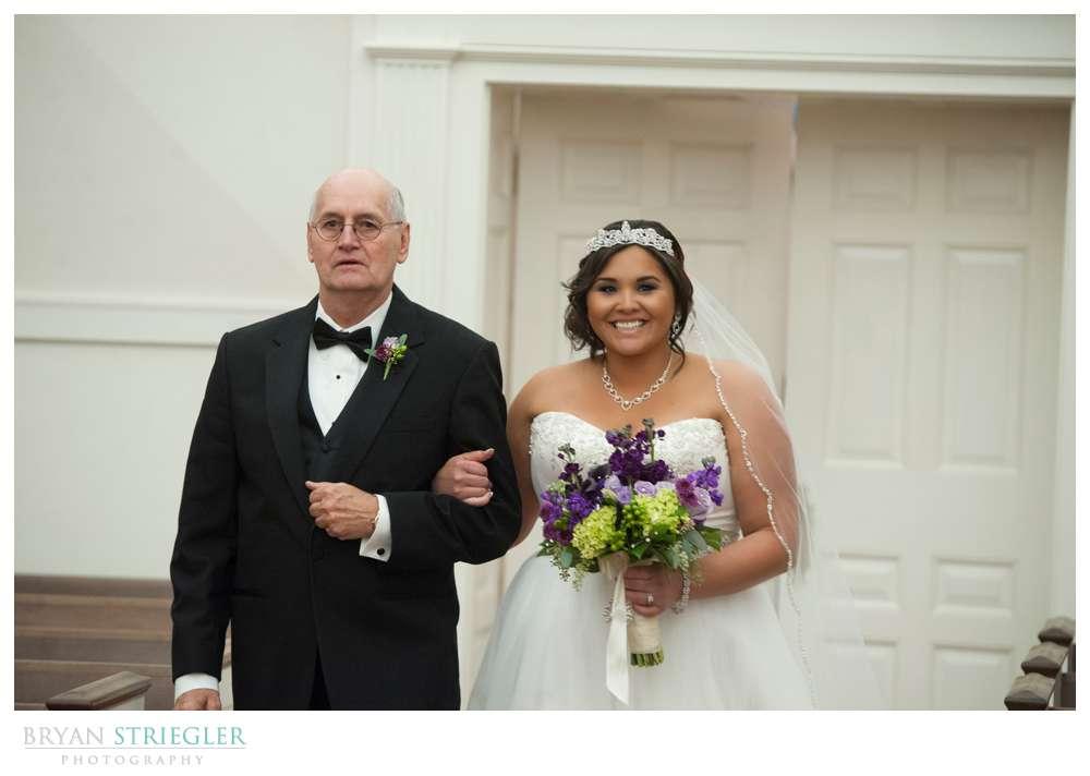 Northwest Arkansas Wedding Photographer walking down the aisle