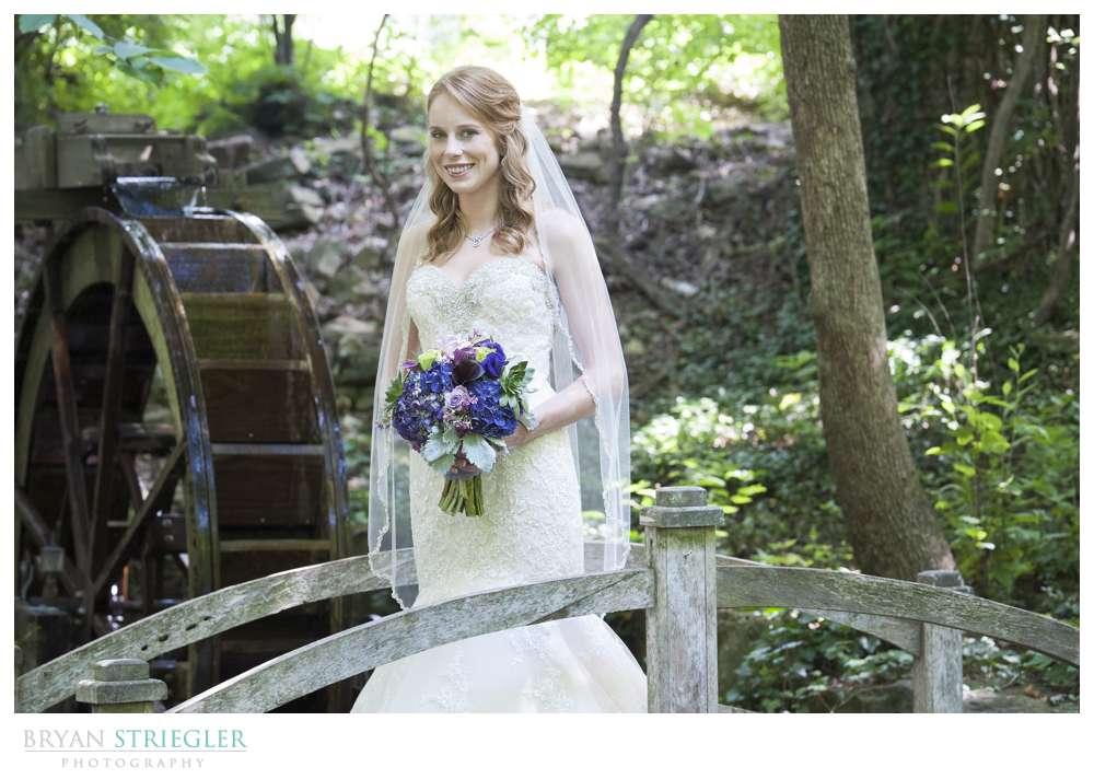 Northwest Arkansas Wedding bride with water wheel