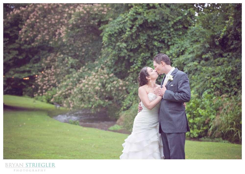 Rogers Wedding Arkansas kissing Creekwood Gardens