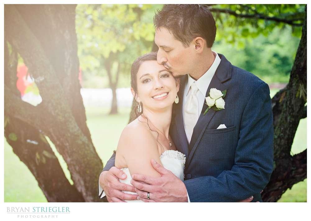 Rogers Wedding Arkansas kiss on forehead