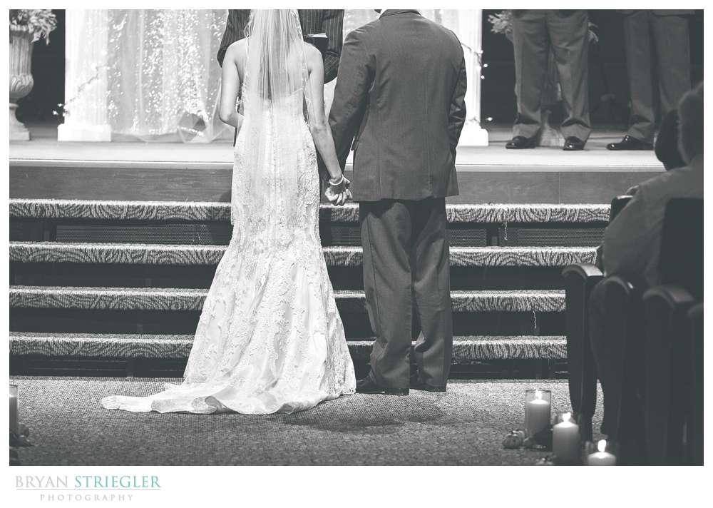 Springdale Arkansas Wedding holding hands black and white