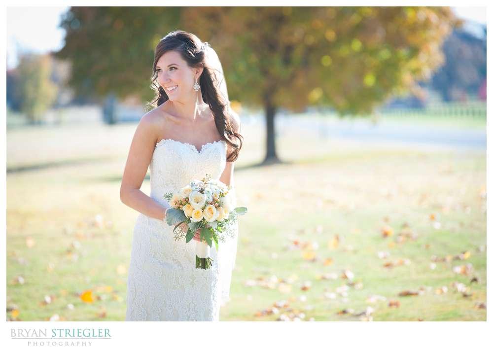 Springdale Arkansas Wedding bride with flowers outside