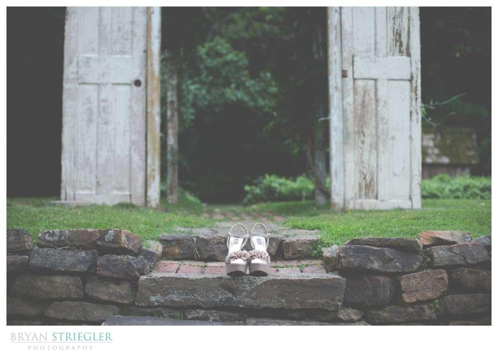 Rogers Wedding Arkansas shoes in front of doors