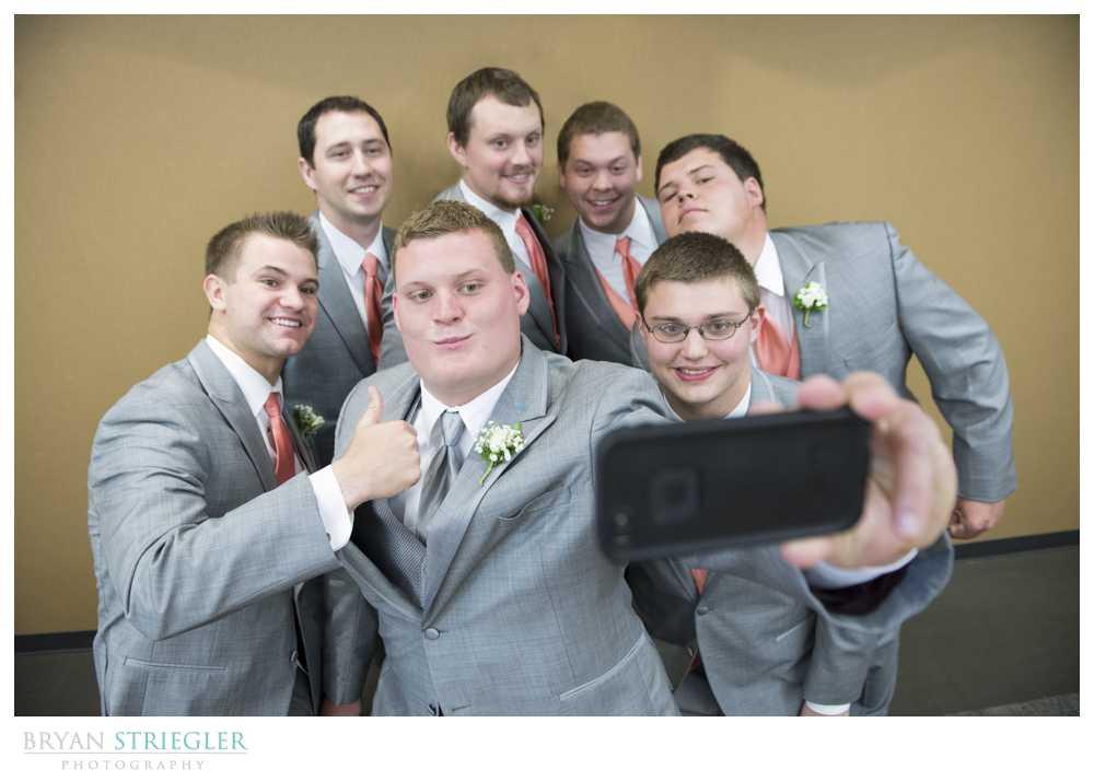 bridal party photos selfie with groomsmen