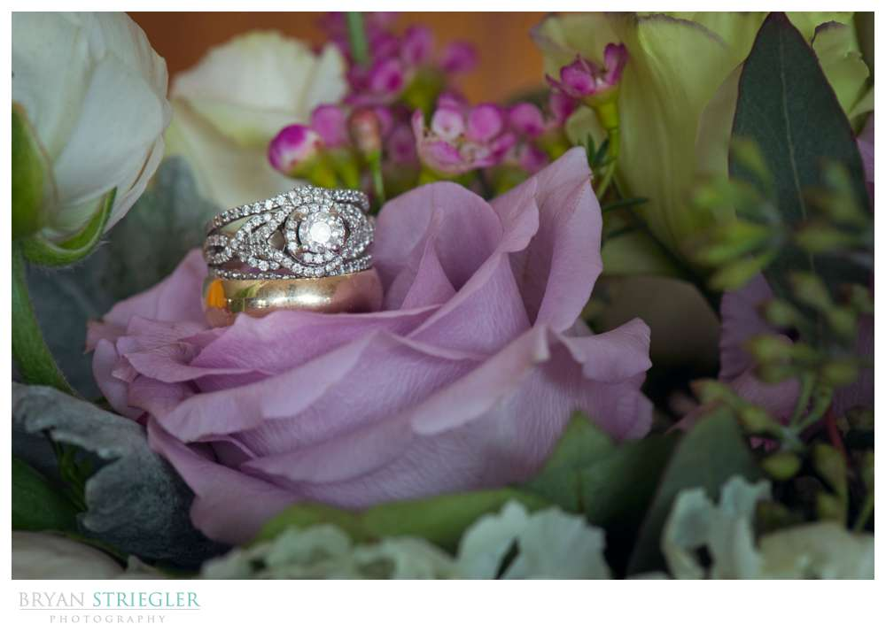 Fayetteville wedding photographer wedding ring in flowers