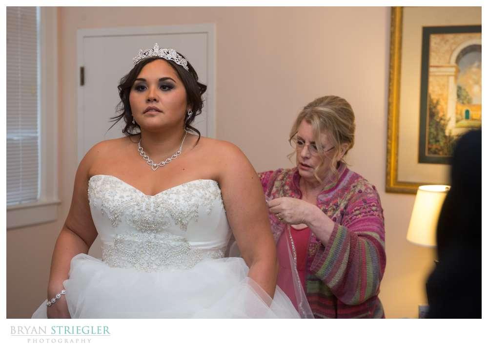 Northwest Arkansas Wedding Photographer putting on dress