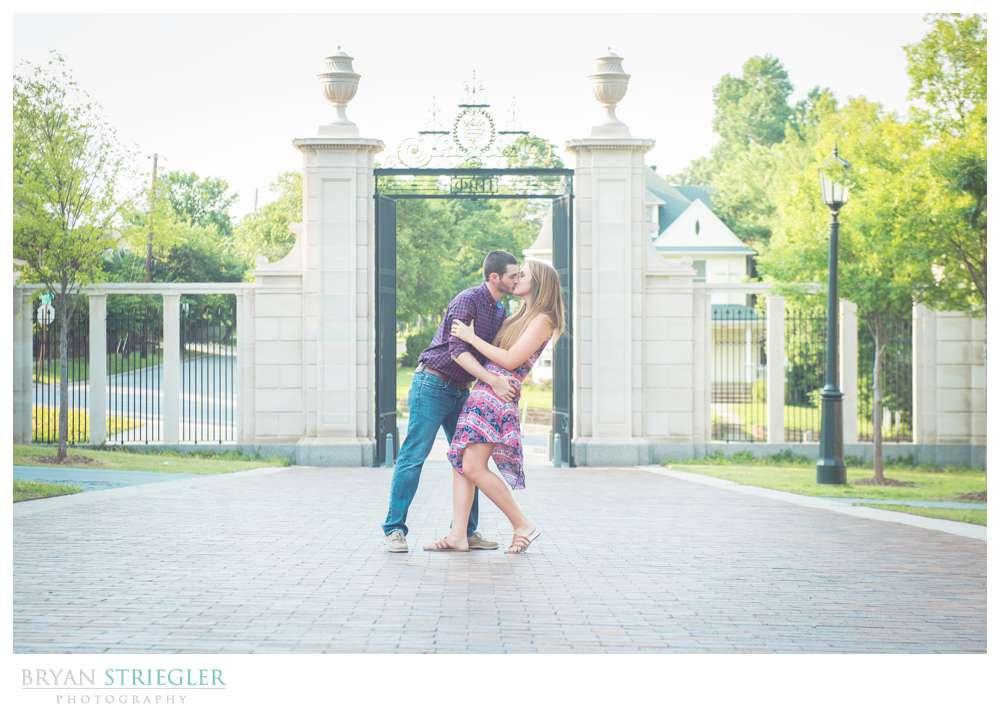Arkansas Engagement Photos dip in front of gateway