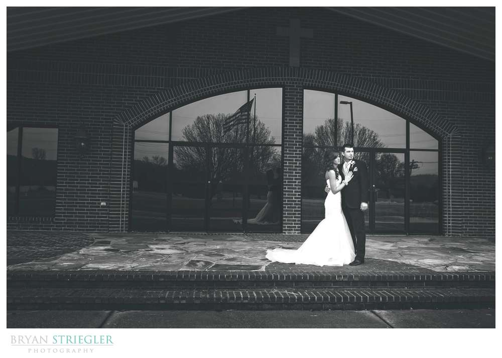 Fayetteville wedding photographer black and white couple portrait front of church