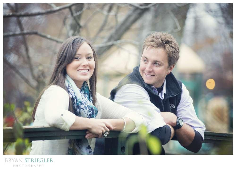 Engagement Photos leaning on bridge