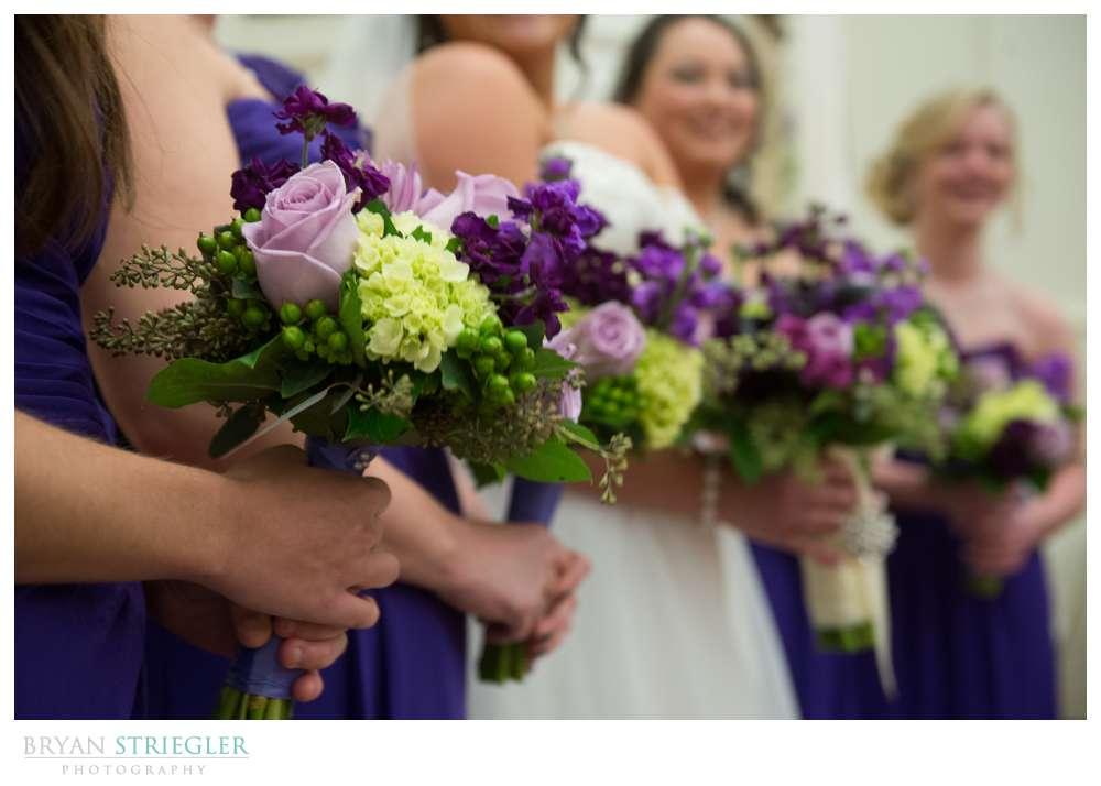 Northwest Arkansas Wedding Photographer brides maids holding flowers