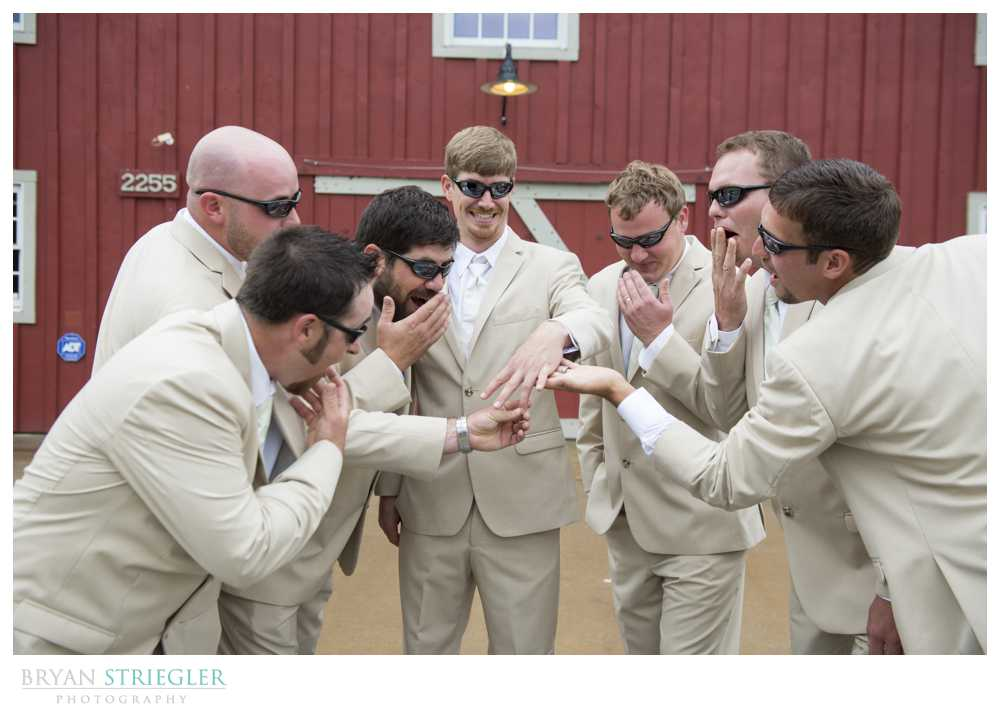 bridal party photos groom showing off ring