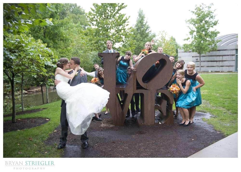 Northwest Arkansas Wedding Photographers Love statue bridal party