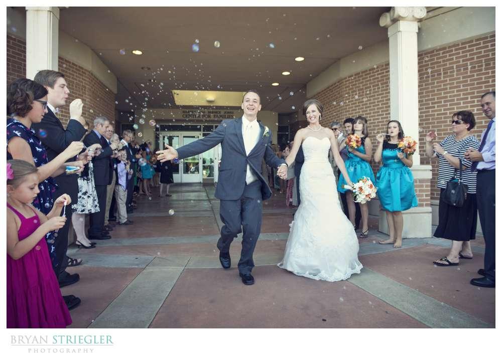 Northwest Arkansas Wedding Photographers bubble exit