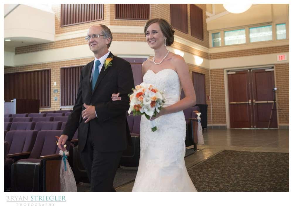 Northwest Arkansas Wedding Photographers walking down aisle