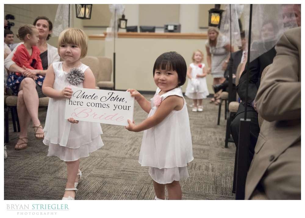 Arkansas wedding flower girls with sign