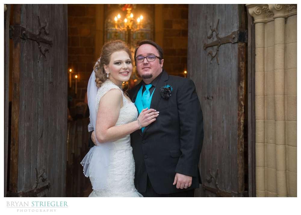 Fayetteville Wedding Photographer bride and groom in doorway of St. Catherine's